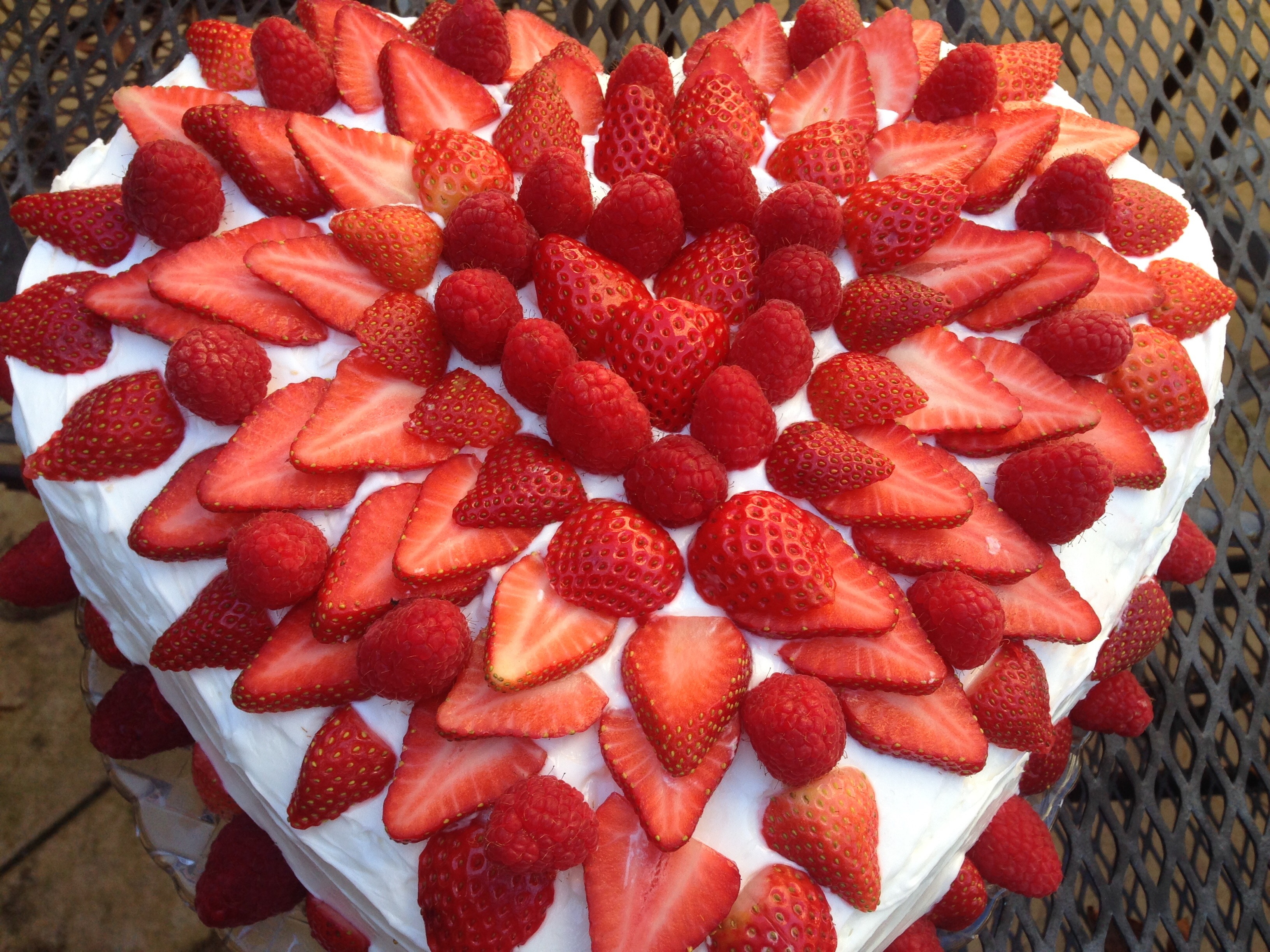 Decorating a heart shaped cake cooking with trader joe 39 s - How to slice strawberries for decoration ...